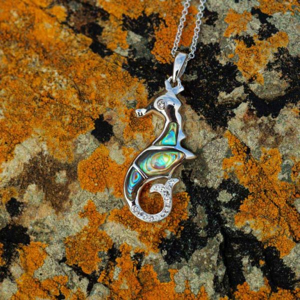 Seahorse Necklace on Beach Rocks