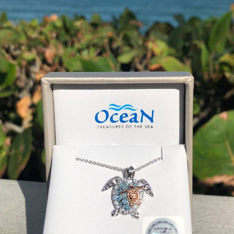 Mother and Baby Turtle Necklace on beach